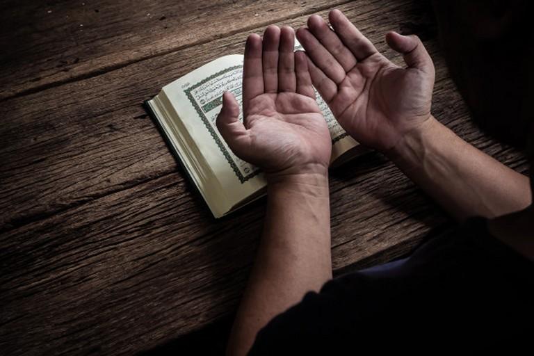 Musulmano con il Corano